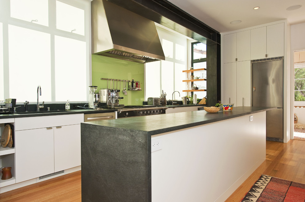 tempered glass table top Kitchen Contemporary with back-painted glass concrete floating shelves glass backsplash green hardwood floors island rug
