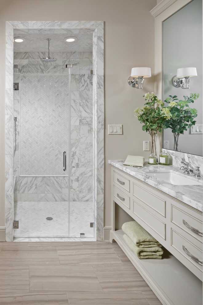 toiletry kit Bathroom Traditional with candle fireplace Honed marble floor Kichler lighting master bathroom
