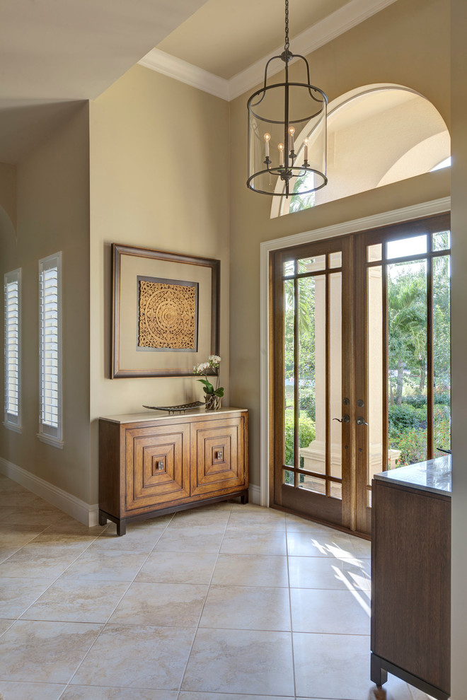 tommy bahama bedding Entry Transitional with arched window beige walls commode console double doors entry doors entry furniture