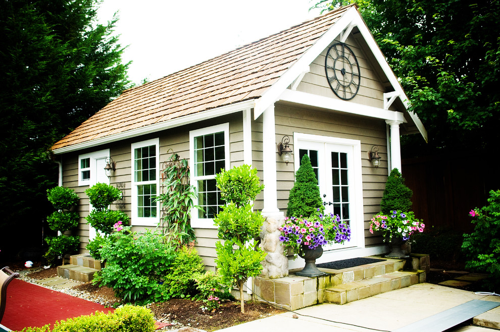 Topiary Plants Garage and Shed Craftsman with a Frame Backyard Barbeque Bbq Beige Exterior Beige Siding Built in Bbq