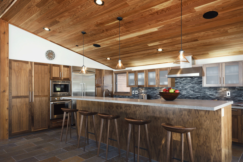 tractor seat bar stools Kitchen Rustic with breakfast bar cabin ceiling lighting dark floor eat in kitchen floor tile
