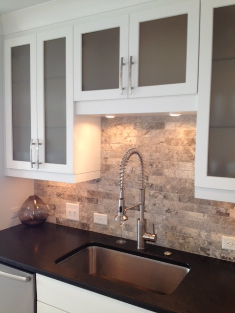Travertine Tile Backsplash Spaces Modern with Absolute Black Granite Bright White Cabinets Eddie Rider Designs Frosted Glass Cabinets