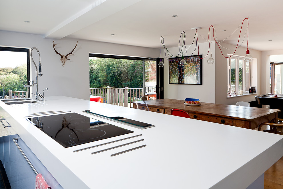 Trivets Kitchen Contemporary with Bi Fold Doors Blue Kitchen Cabinets Ceiling Light Corian Worktop Kitchen Island