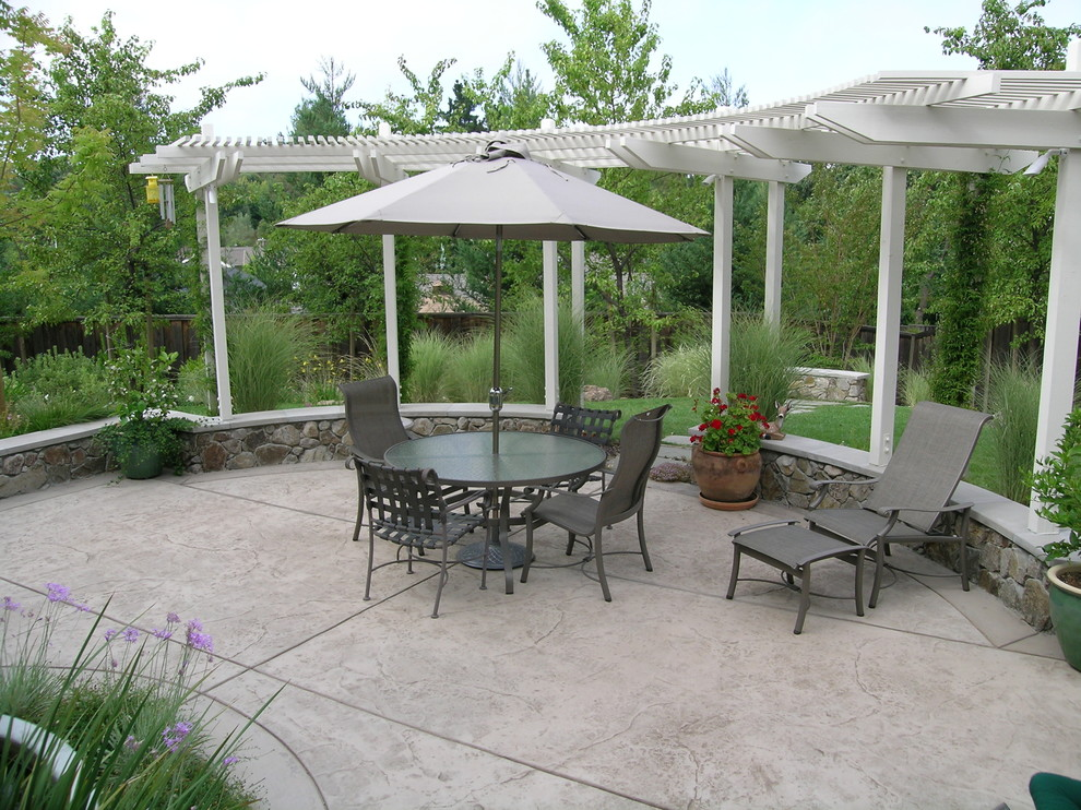 Tropitone Patio Traditional with Arbor Chaise Lounge Concrete Concrete Paving Container Plant Grass Lawn Neutral Colors