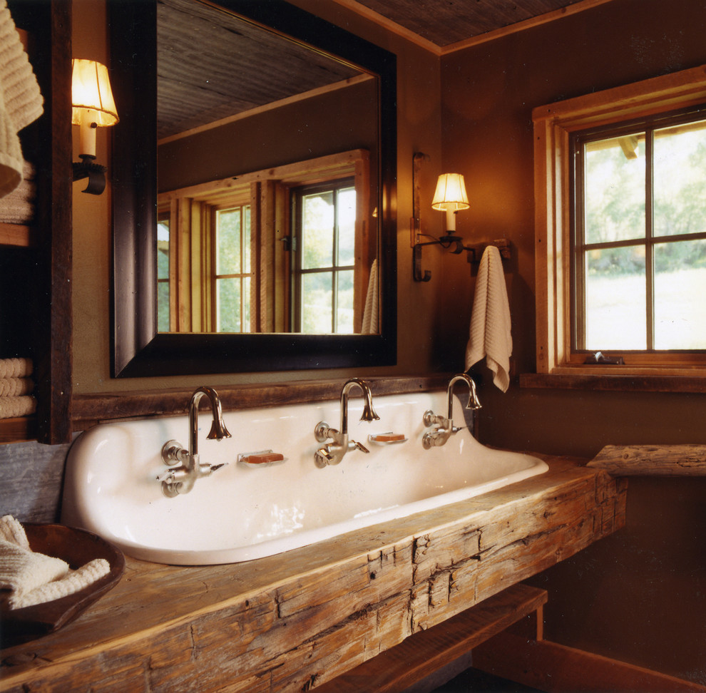 trough sink bathroom Bathroom Rustic with above counter sink bathroom cabin Candace Miller Architects lodge rustic wall sconce