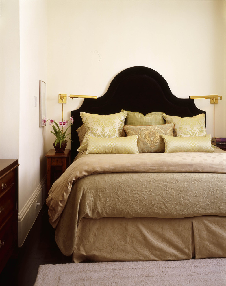 tufted headboard queen Bedroom Eclectic with area rug baseboard bedside table bedskirt black bed container plant dark floor