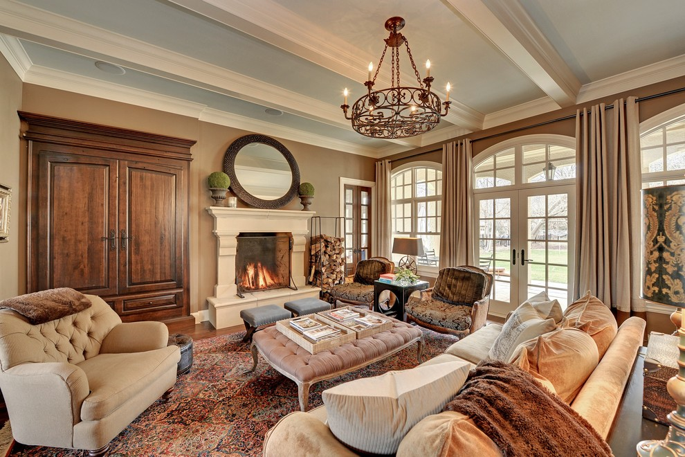 Tufted Ottoman Coffee Table Living Room Traditional with Arched Windows Area Rug Artwork Beige Sofa Beige Walls Built in Armoire Carved