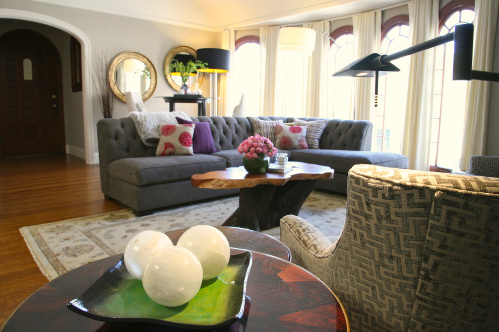 Tufted Sectional Sofa Living Room Eclectic with Bar Stools Bar Table Burl Wood Table Circular Mirror Colorful Pillows Glass