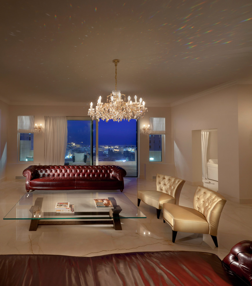 Tufted Slipper Chair Living Room Contemporary with Chandelier Chesterfield Curtains Drapes Glass Coffee Table Glass Doors Gold Chairs Marble2