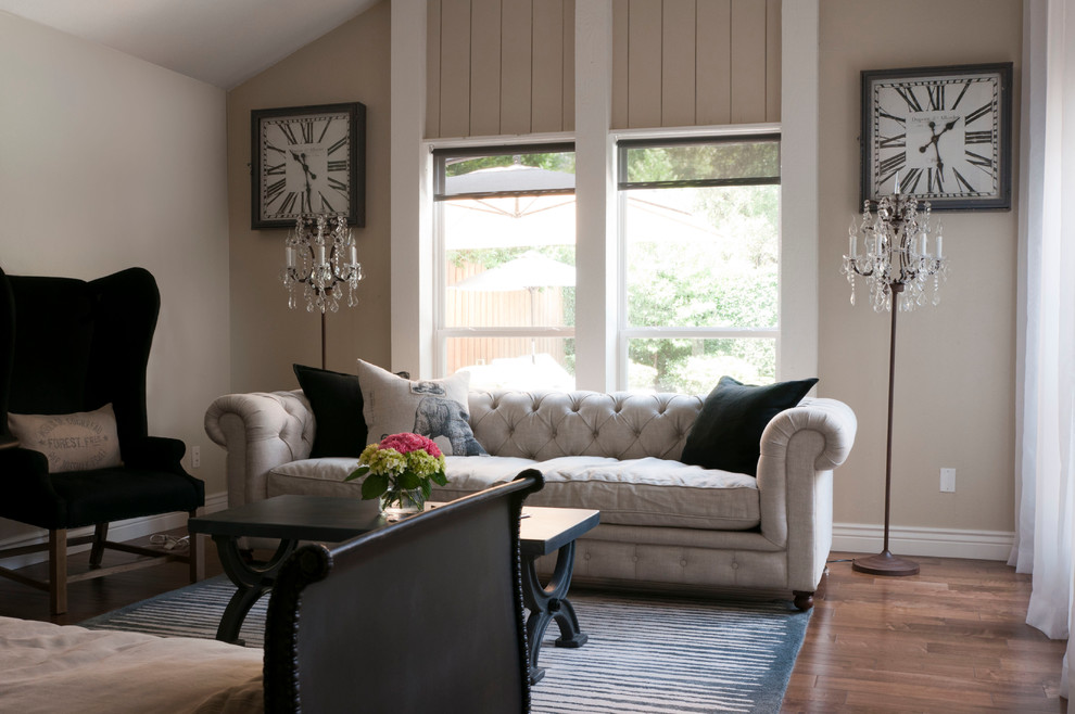 Tufted Sofas Living Room Transitional with Baseboard Beige Walls Black Coffee Table Black Wing Chair Blue and White