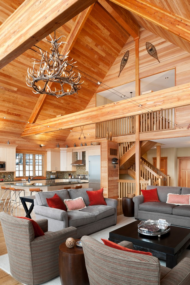 Twin Sleeper Sofa Family Room Rustic with Armchairs Cathedral Ceiling Chandelier Coffee Table Exposed Beams Gray Sofa Red Round