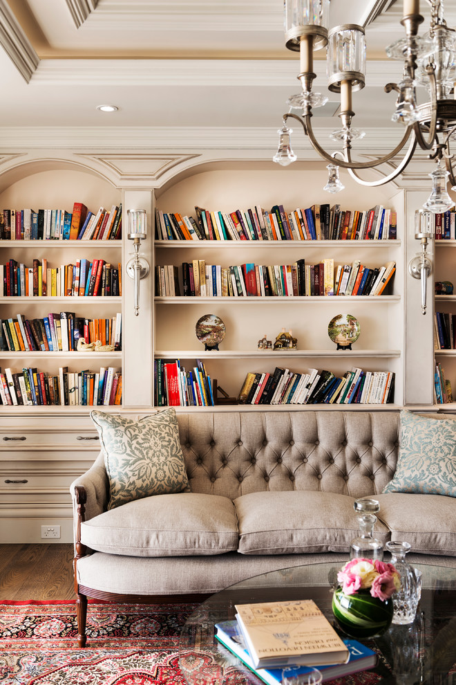 unique bookshelves Living Room Traditional with built-in bookcases button upholstery coffered ceiling custom designed cabinets Hampton Style Luxury