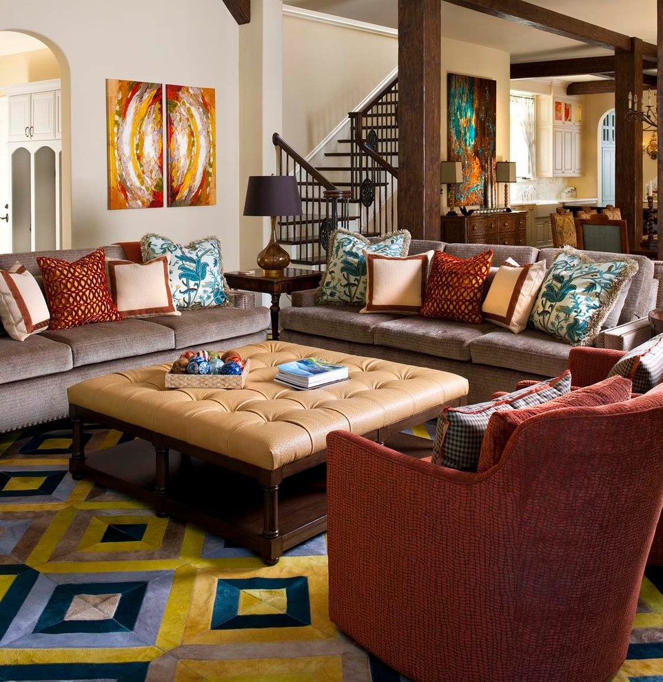 Upholstered Coffee Table Family Room Mediterranean with Arch Arches Art Beam Beige Ottoman Beige Wall Blue Blue Patterned Rug