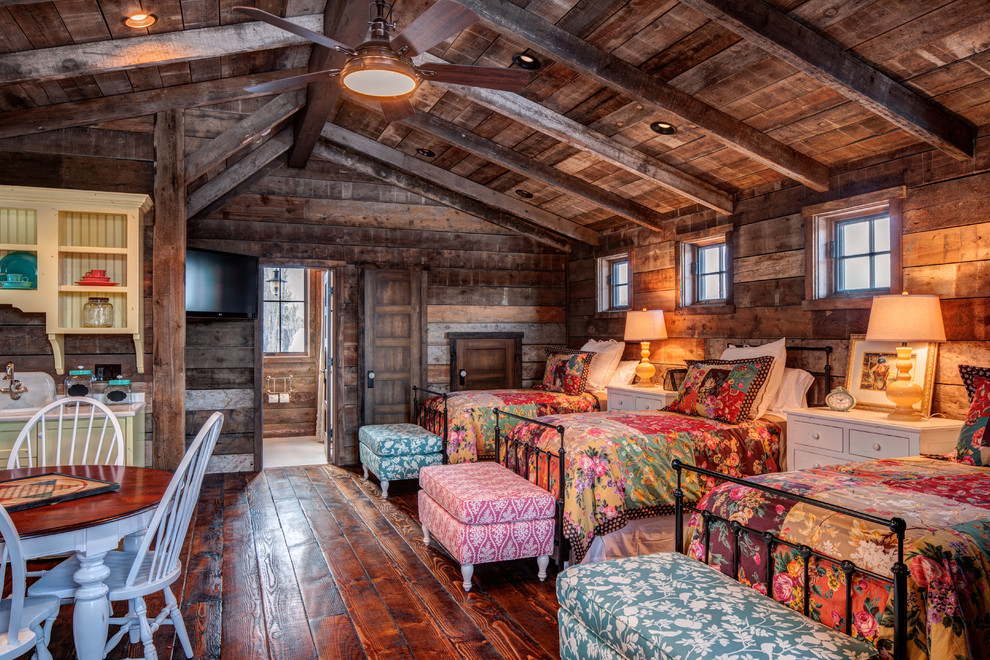 Upholstered Storage Bench Bedroom Traditional with Bold Floral Cabin Camp Dark Wood Floor Exposed Beams Foot Board Headboard