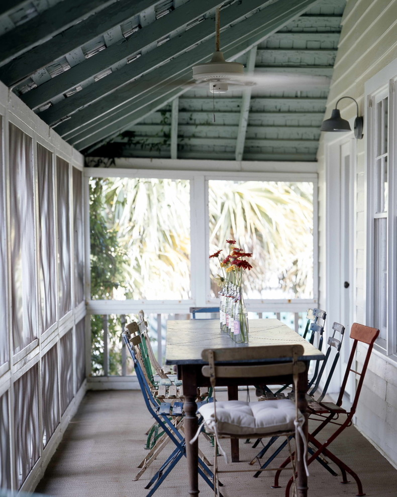 used rowing machine Porch Shabby chic with bottle vases ceiling fan covered porch exposed beams indoor outdoor mismatched dining