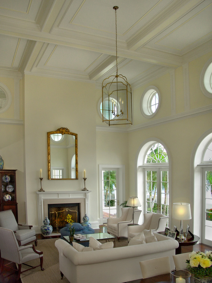 Vaughan Bassett Furniture Living Room Traditional with Arched Window Armchair Candle Holders China Cabinet Coffee Table Coffered Ceiling Fireplace