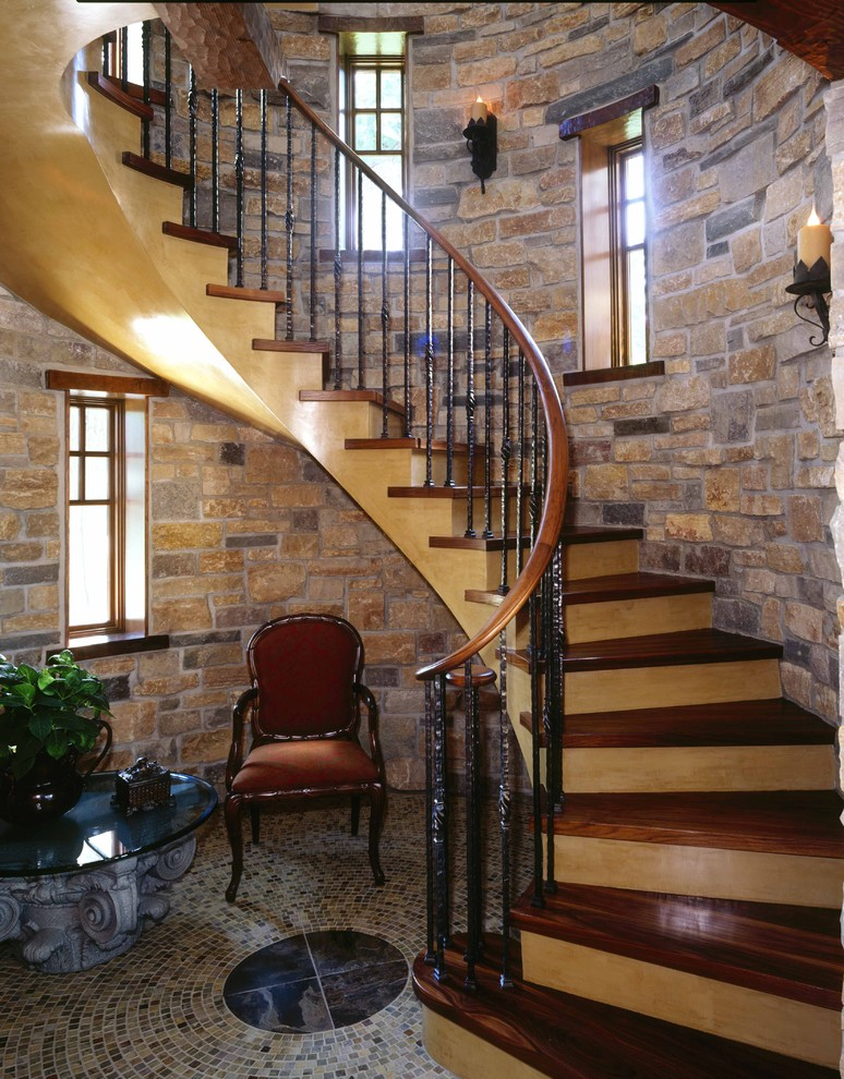 Wall Candle Sconces Staircase Traditional with Brick Wall Brown Upholstered Chair Curved Staircase Dark Wood Staircase Glass Coffee