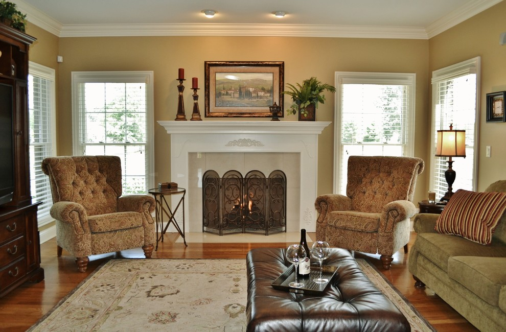 Wall Hugger Recliners Family Room Traditional with Armchair Art Above Fireplace Crown Molding Family Friendly Family Room Fireplace Ottoman