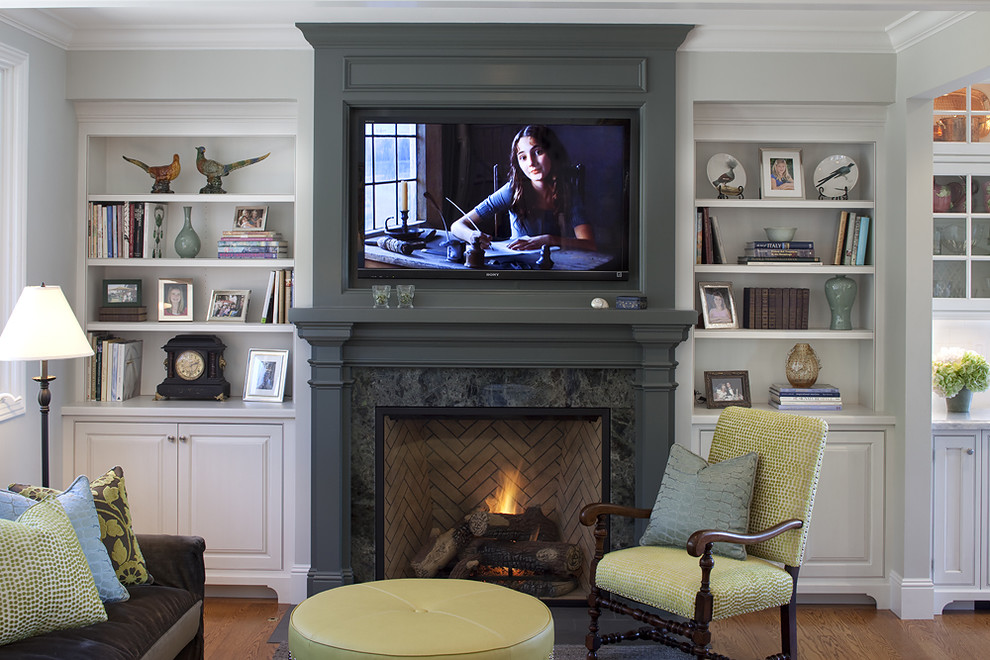 Wall Mount Fireplace Family Room Traditional with Bookcase Bookshelves Built in Shelves Built in Storage Crown Molding Decorative Pillows
