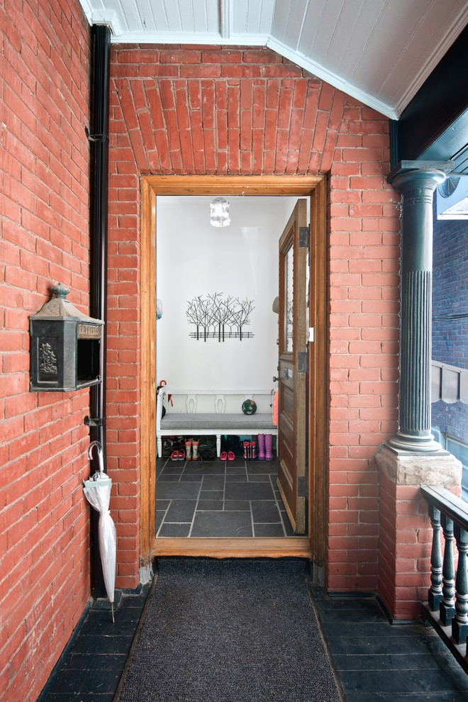wall mount mailbox Entry Transitional with black floor tile brick exterior brick walls columns covered porch My Houzz