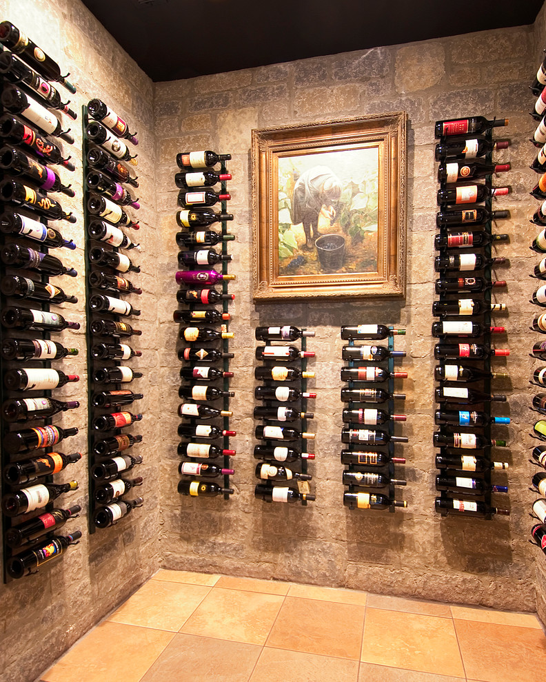 Wall Mount Wine Rack Wine Cellar Traditional with Built in Storage Dark Ceiling Framed Artwork Old World Stone Walls Tile Floor Wall