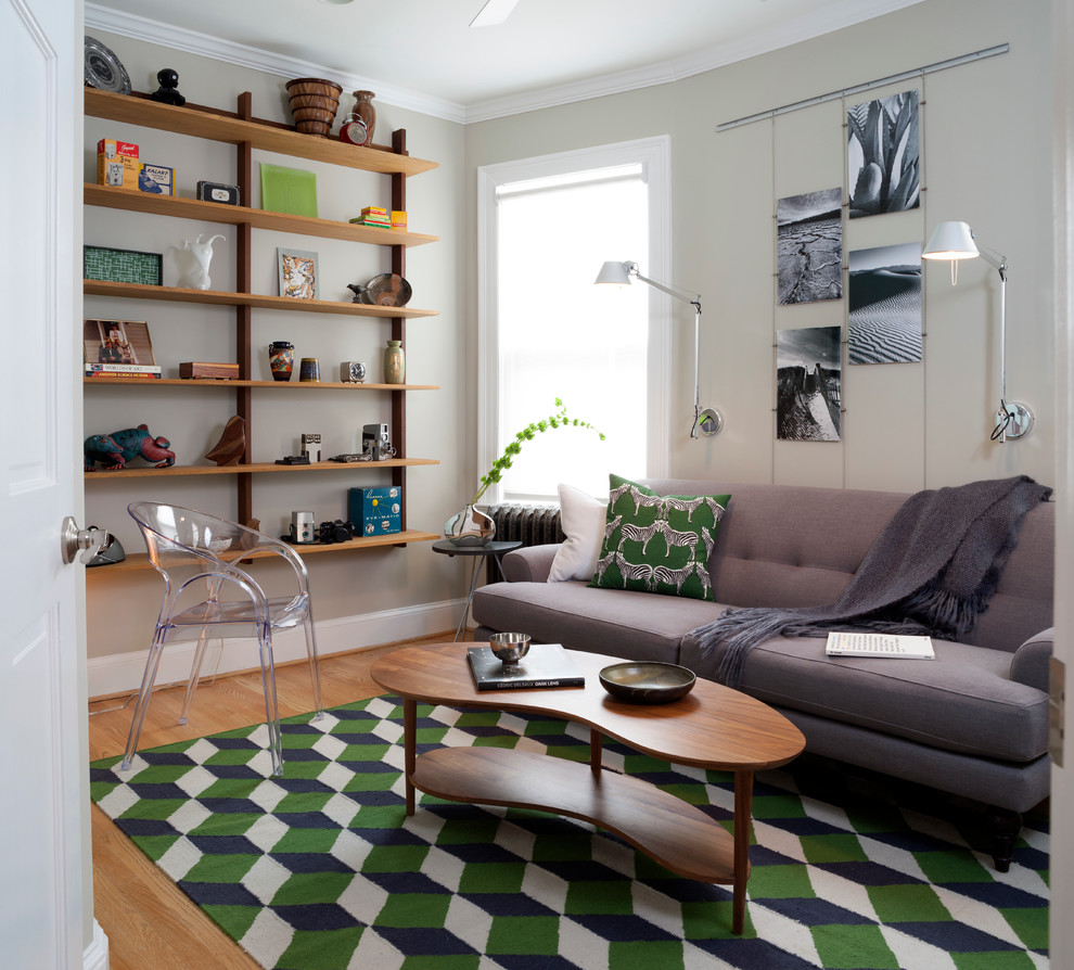 wall mounted bookcase Living Room Midcentury with black and white photos clear armchair gray sofa gray throw green geometric