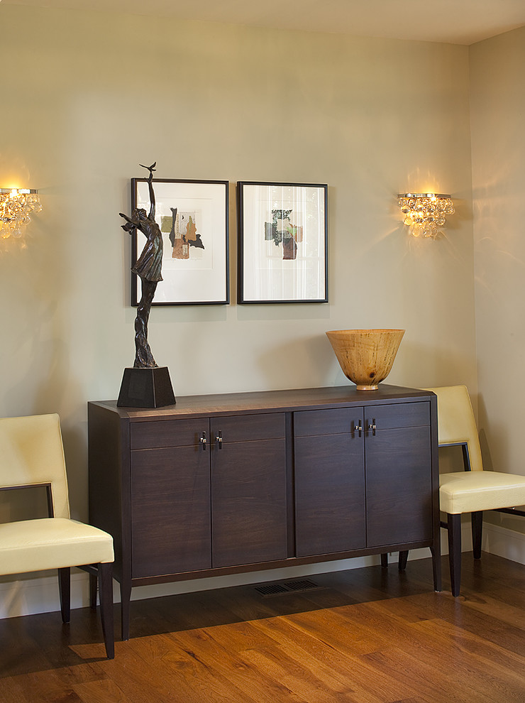 Wall Sconce Dining Room Contemporary with Credenza Leather Dining Chairs Neutral Colors Sconce Sculptures Sideboard Statues Wall Art