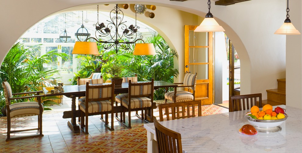 Wardrobe Closets Dining Room Mediterranean with Arched Wall Opening Colorful Dining Table French Door Indoor Plants Pendant Lights