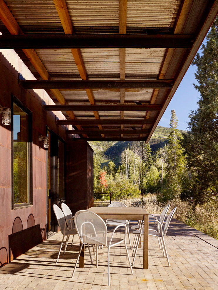 Warmly Yours Patio Modern with Brick Corten Steel Eaves Metal Cafe Chairs Metal Roof Natural Landscape Overhang