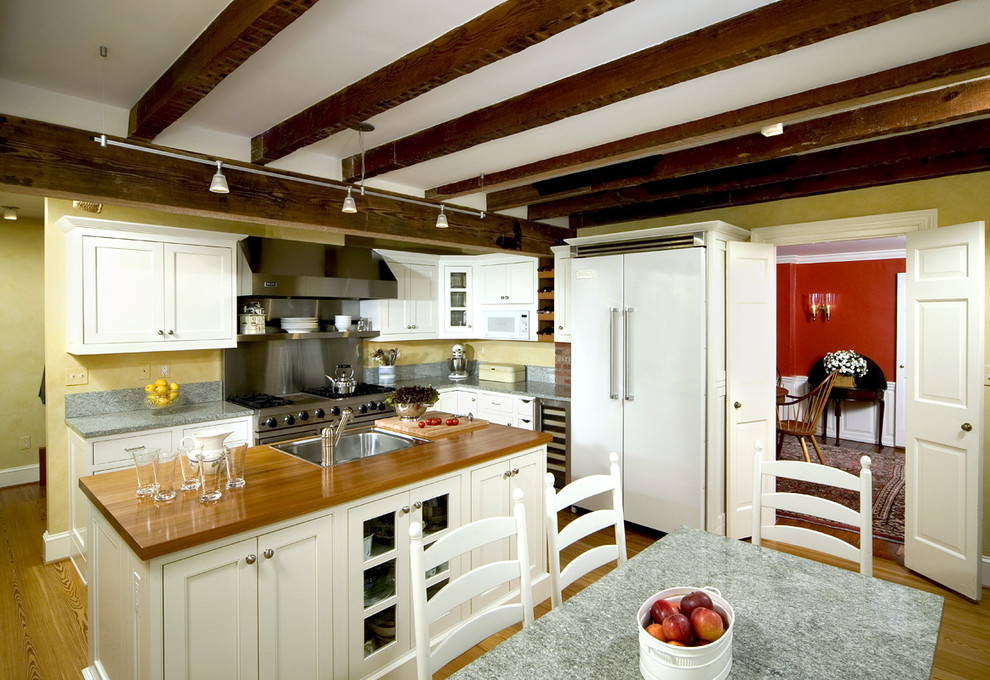 Whistling Tea Kettle Kitchen Traditional with Baseboards Country Kitchen Exposed Beams Kitchen Island Kitchen Table Mixed Countertops Range
