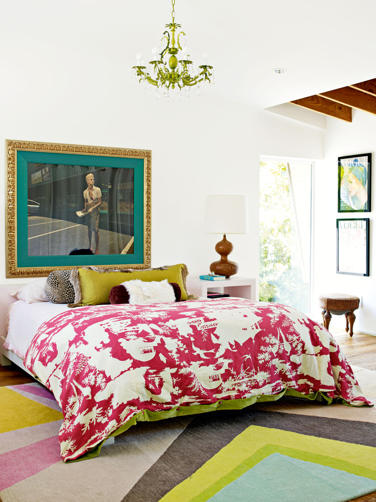 White Bedspread Bedroom Eclectic with Artwork Bright Pattern Rug Decorative Pillows Exposed Wood Beams Gold Frame Graphic