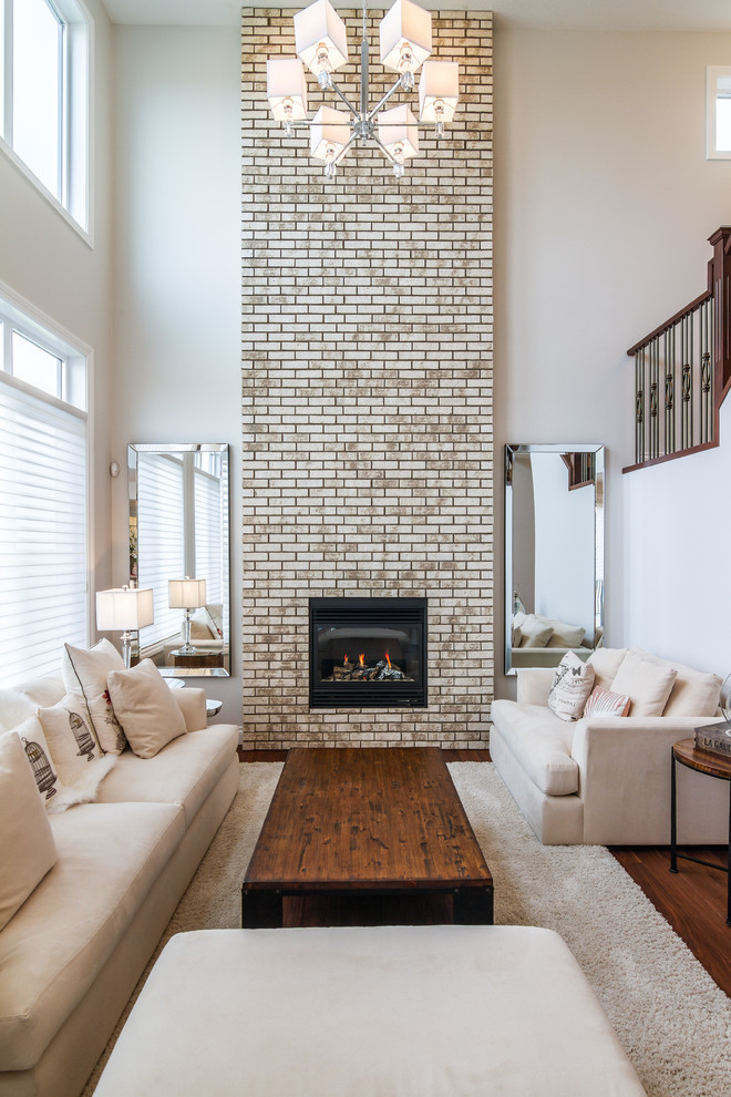 White Loveseat Living Room Traditional with Brick Fireplace Chandelier High Ceiling Inset Fireplace Off White Rug Two Mirrors White