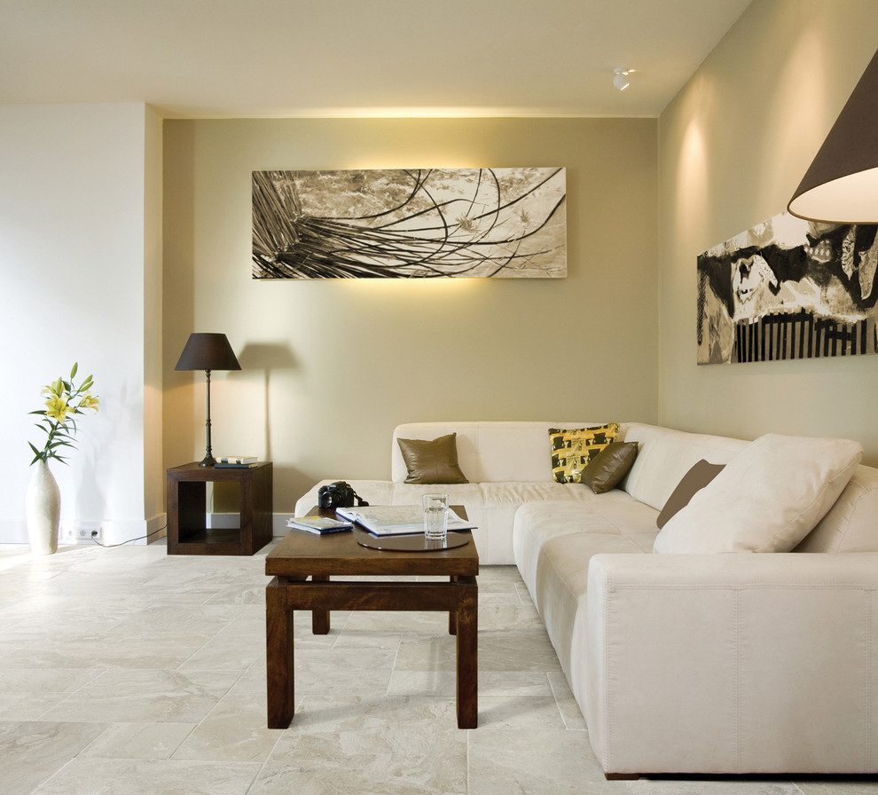 White Shag Rug Living Room with Bronze Accents Cream Floor Tiles Cream Sectional Dark Wood Coffee Table Gold