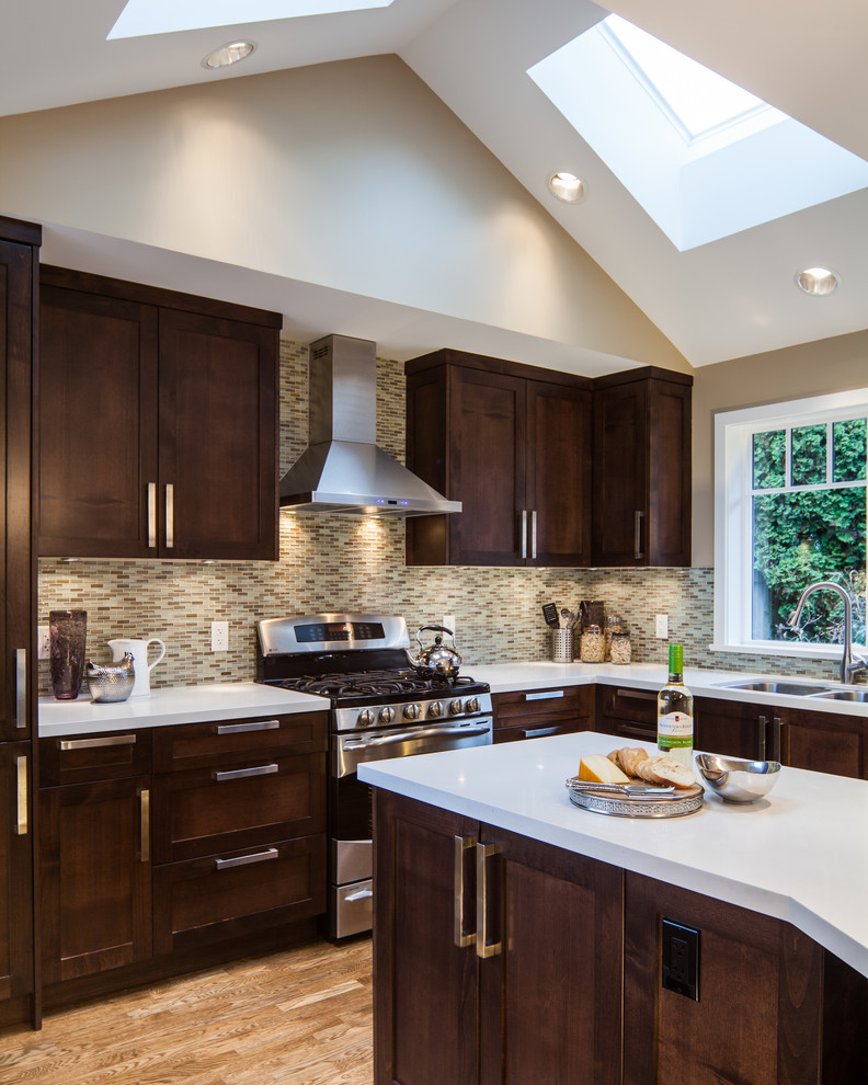 whitehall products Kitchen Transitional with cove lighting irregular shaped counter kitchen island storage range recessed lighting skylights