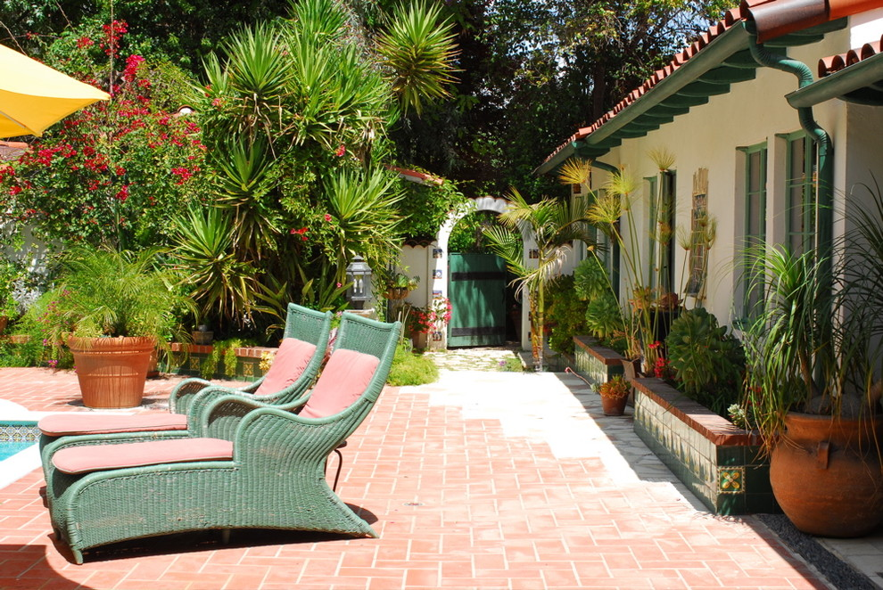 Wicker Chaise Lounge Patio Mediterranean with Arch Green Chaise Lounge Green Gate Green Tile Planters Mediterranean Tile Wall