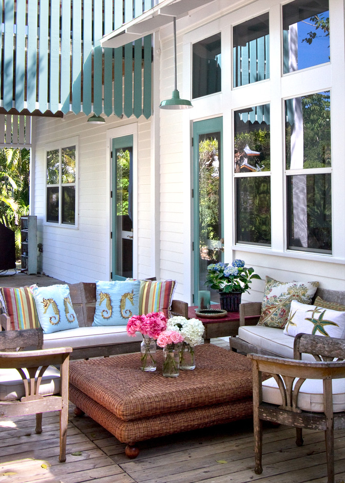 wicker ottoman Porch Tropical with barn lights bench seats coastal covered porch Exterior green green painted trim