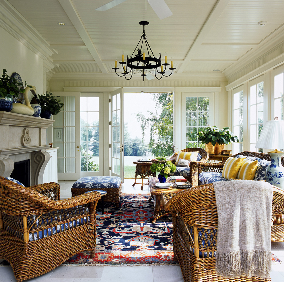 Wicker Ottoman Sunroom Traditional with Beige Bead Board Beige Stone Floor Beige Throw Blue Patterned Cushions Ceiling