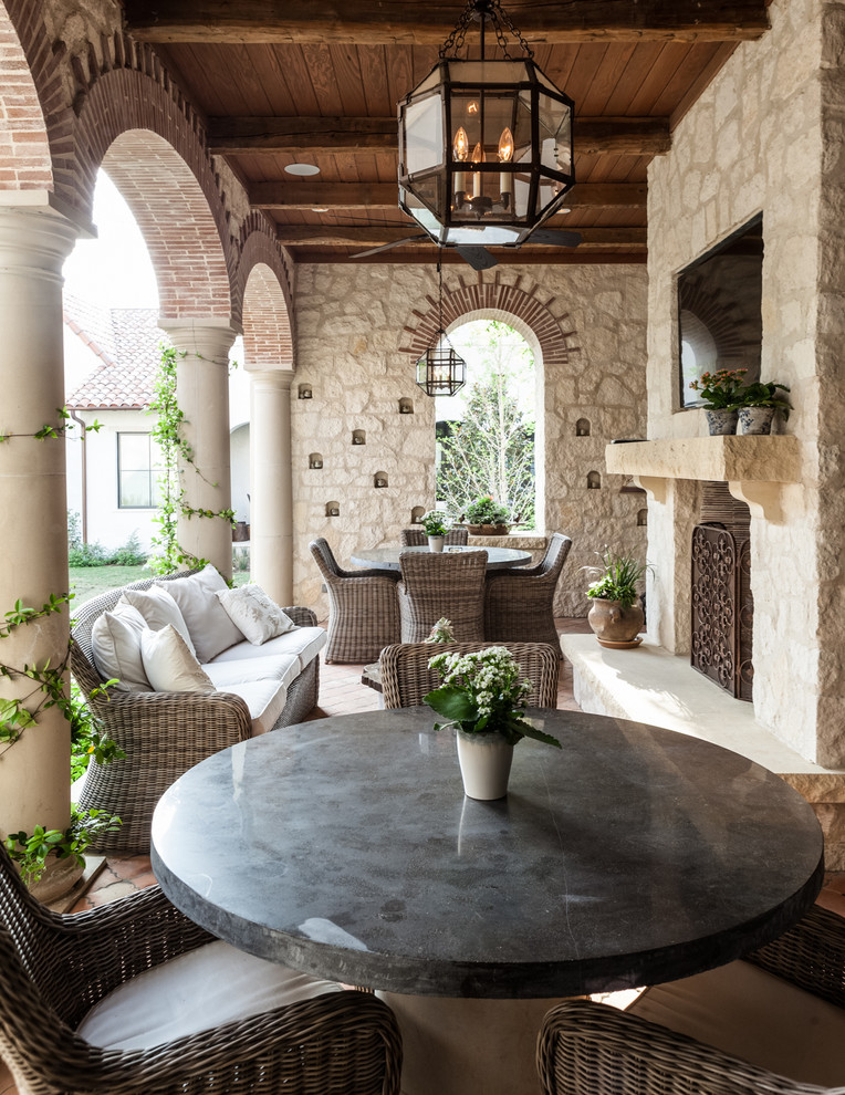 Wicker Patio Chairs Patio Mediterranean with Arch Archway Brick Arch Column Covered Patio Fireplace Screen Hanging Lantern Outdoor