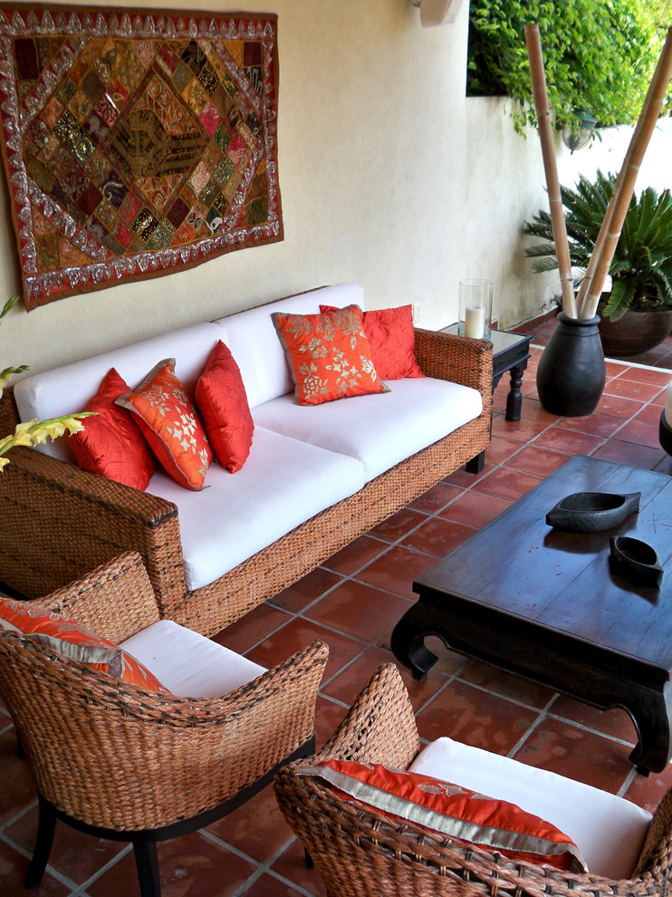 Wicker Patio Furniture Patio Tropical with Asian Black Coffee Table Black Vase Floral Pillows Hardscape Orange Tile Patio