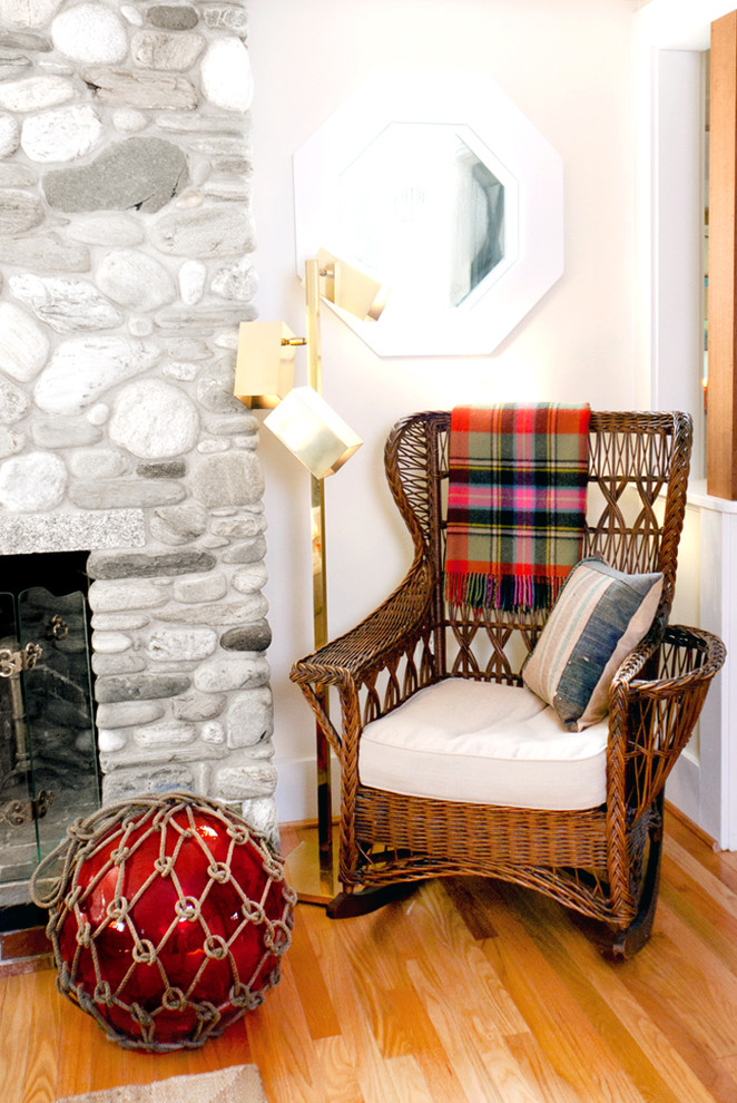 Wicker Rocking Chair Living Room Beach with Glass Fishing Float Reading Nook Red Accent Stone Fireplace Surround Wicker Rocking