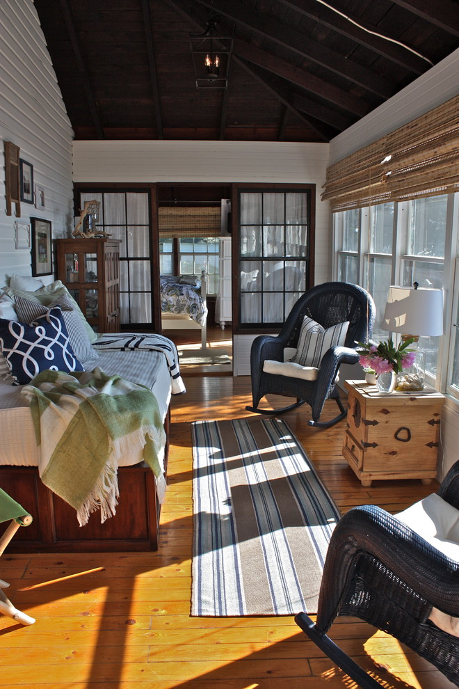 wicker rocking chair Sunroom Traditional with bamboo roman shade bamboo roman shades cottage daybed hanging lantern lake house