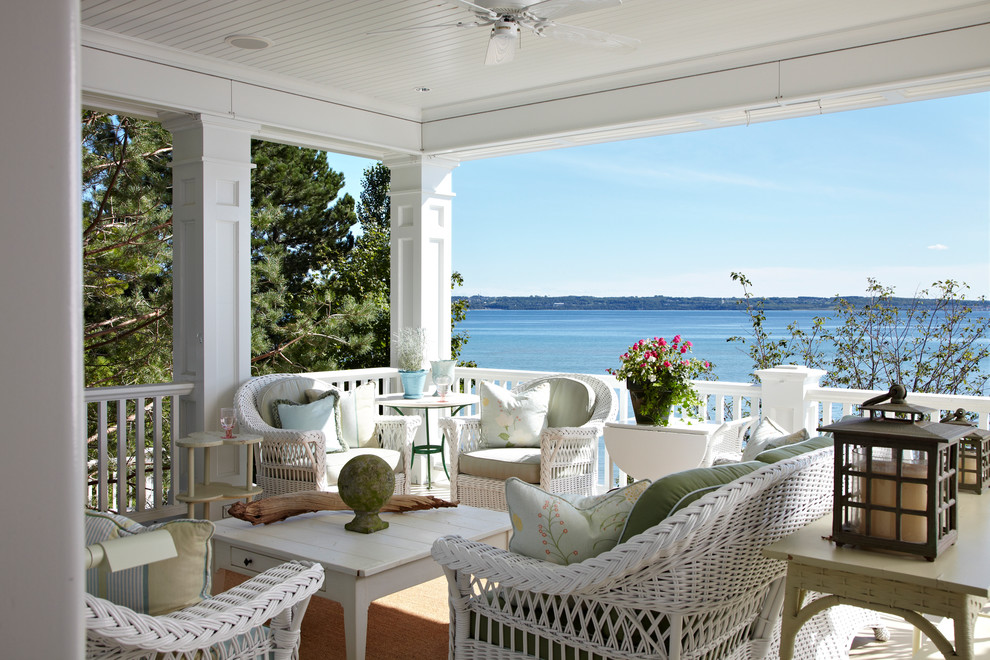 Wicker Sofa Porch Traditional with Lanterns Water View Waterfront White Ceiling White Ceiling Fan White Columns White