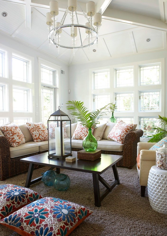 Wicker Sofa Sunroom Beach with Beachy Casual Floral Pillows Gray Shag Rug Green Glass Vase Hurricane Lantern
