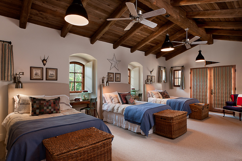 Wicker Trunk Bedroom Mediterranean with Arched Window Beige Bedding Beige Headboard Beige Wall Black Pendant Light Blue