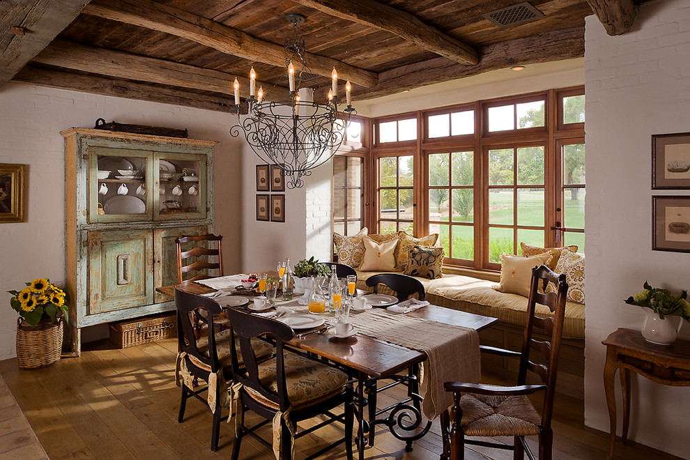 wicker trunk Dining Room Farmhouse with casement windows Distressed paint exposed wood beams farmhouse French country rough hewn