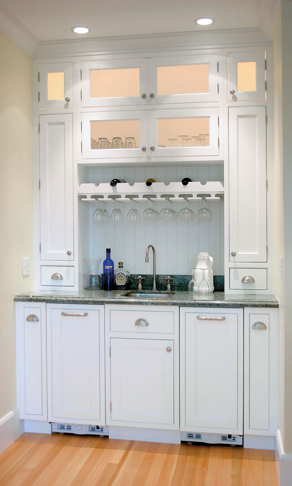 wine glass racks Home Bar Traditional with beadboard ceiling lighting crown molding door handles drawer pulls glass front cabinets