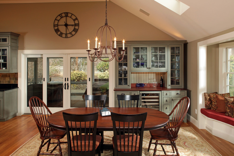 wine hutch Dining Room Traditional with area rug bench seat beverage cooler chandelier dining table double patio doors