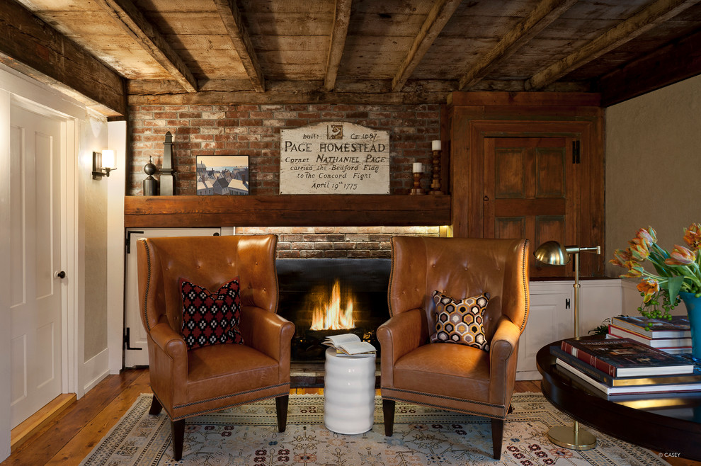 Wingback Chairs Home Office Rustic with Area Rug Baseboards Brick Fireplace Brick Fireplace Surround Exposed Beams Exposed Wooden