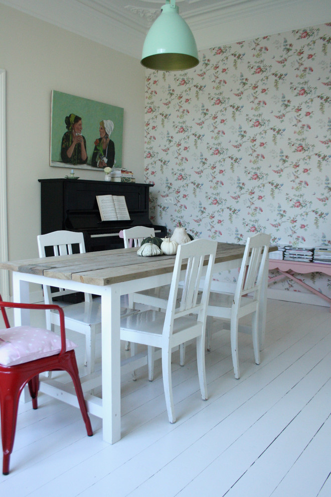 women briefcase Dining Room Eclectic with artwork dining chairs dining table farm table interior wallpaper painted floors painted