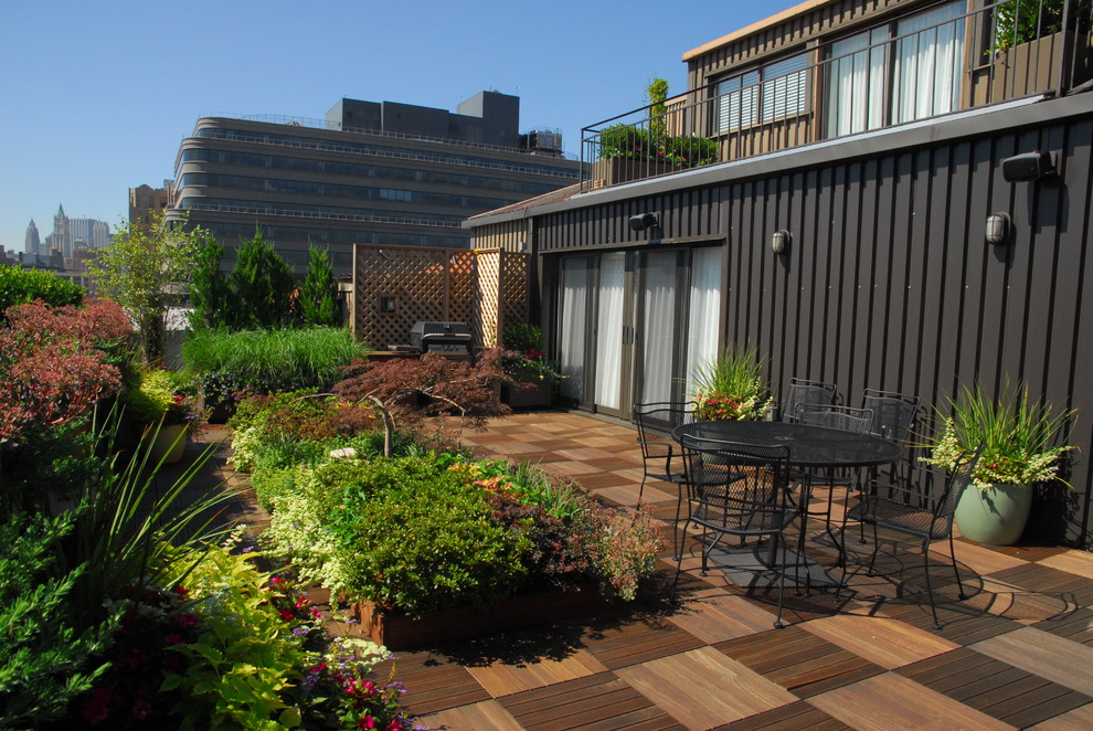 Wood Deck Tiles Patio Contemporary with Brown Exterior Brown Siding Bushes Checkered Wood Patio Iron Railing Metal Exterior